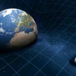 Esta imagem mostra que os objetos celestes fazem entalhes no tecido do espaço-tempo. A Terra, sendo 81 vezes mais massiva que sua lua (à direita), induz uma maior curvatura. De acordo com a relatividade geral, esta curvatura é o que nós percebemos como gravidade. Crédito da imagem: Mark Garlick / Science Source.