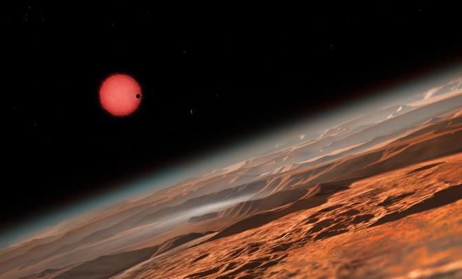 Nesta ilustração, um dos planetas interiores visto em trânsito através do disco de sua pequena e tênue estrela. Créditos: ESO / M. Kornmessers.