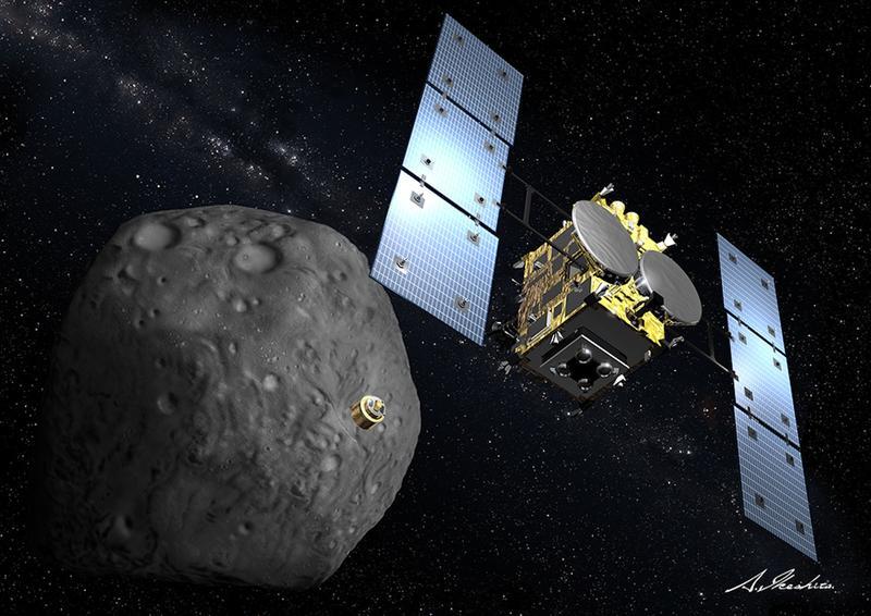 Representação artística da nave espacial japonesa Hayabusa 2, liberando uma sonda enquanto orbita o asteroide Ryugu. Crédito: JAXA.